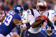 LeGarrette Blount #29 of the New England Patriots attempts to avoid the tackle of Devon Kennard #59 of the New York Giants at MetLife Stadium on November 15, 2015 in East Rutherford, New Jersey.