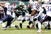 Running back Chris Ivory #33 of the New York Jets carries the ball against the New England Patriots during a game at MetLife Stadium on December 21, 2014 in East Rutherford, New Jersey.