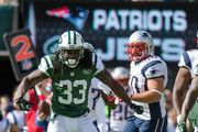 Running back Chris Ivory #33 of the New York Jets celebrates after a run in the 1st quarter against the New England Patriots at MetLife Stadium on October 20, 2013 in East Rutherford, New Jersey.