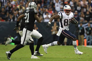 Dwayne Allen #83 of the New England Patriots runs with the ball after a reception against the Oakland Raiders during the second half at Estadio Azteca on November 19, 2017 in Mexico City, Mexico.