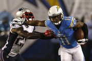 Wide receiver Eddie Royal #11 of the San Diego Chargers runs past cornerback Kyle Arrington #25 of the New England Patriots at Qualcomm Stadium on December 7, 2014 in San Diego, California.