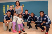 New England Revolution's (L to R) Charlie Davies, Brad Knighton, Kelyn Rowe, Andrew Farrell, and London Woodberry take a pictures with Bingo players at Boston Children's Hospital April 28, 2015 in Boston, Massachusetts.