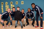 New England Revolution's (L to R) Brad Knighton, Kelyn Rowe, Charlie Davies, Andrew Farrell, and London Woodberry take a picture with James at Boston Children's Hospital April 28, 2015 in Boston, Massachusetts.