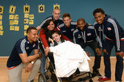 New England Revolution's (L to R) Charlie Davies, Brad Knighton, Kelyn Rowe, Andrew Farrell, and London Woodberry take a picture with Billy and Mom at Boston Children's Hospital April 28, 2015 in Boston, Massachusetts.