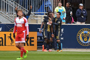 C.J. Sapong #17 of Philadelphia Union is congratulated by teammates Chris Pontius #13 and Ilsinho #25 as Kelyn Rowe #11 of New England Revolution walks away at Talen Energy Stadium on March 20, 2016 in Chester, Pennsylvania.