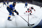 Robert Bortuzzo #41 of the St. Louis Blues and Marcus Johansson #90 of the New Jersey Devils battle for the puck at Scottrade Center on January 2, 2018 in St. Louis, Missouri.