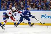 Ryan Callahan #24 of the Tampa Bay Lightning avoids the check of Will Butcher #8 of the New Jersey Devils in the first period of Game Five of the Eastern Conference First Round during the 2018 NHL Stanley Cup Playoffs at Amalie Arena on April 21, 2018 in Tampa, Florida.