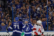 Ryan Callahan #24 of the Tampa Bay Lightning, center, celebrates his empty net goal with Anthony Cirelli #71 as Will Butcher #8 of the New Jersey Devils reacts in the third period of Game Five of the Eastern Conference First Round during the 2018 NHL Stanley Cup Playoffs at Amalie Arena on April 21, 2018 in Tampa, Florida.