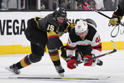 Jon Merrill #15 of the Vegas Golden Knights trips Michael Grabner #40 of the New Jersey Devils in the third period of their game at T-Mobile Arena on March 14, 2018 in Las Vegas, Nevada. The Devils won 8-3.