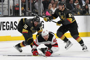Jon Merrill #15 of the Vegas Golden Knights trips Michael Grabner #40 of the New Jersey Devils as David Perron #57 of the Golden Knights defends in the third period of their game at T-Mobile Arena on March 14, 2018 in Las Vegas, Nevada. The Devils won 8-3.