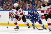 Marcus Johansson #90 of the New Jersey Devils avoids the check of Anthony Cirelli #71 of the Tampa Bay Lightning in the first period of Game Five of the Eastern Conference First Round during the 2018 NHL Stanley Cup Playoffs at Amalie Arena on April 21, 2018 in Tampa, Florida. (Photo by Mike Carlson/Getty Images) *** Local Caption *** Anthony Cirelli;Marcus Johansson