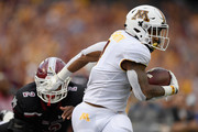 Rodney Smith #1 of the Minnesota Golden Gophers carries the ball against Terrill Hanks #2 of the New Mexico State Aggies during the first quarter of the game on August 30, 2018 at TCF Bank Stadium in Minneapolis, Minnesota.