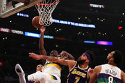 Julius Randle #30 of the New Orleans Pelicans is fouled on a layup attempt by JaVale McGee #7 of the Los Angeles Lakers during the first half at Staples Center on February 27, 2019 in Los Angeles, California. NOTE TO USER: User expressly acknowledges and agrees that, by downloading and or using this photograph, User is consenting to the terms and conditions of the Getty Images License Agreement.