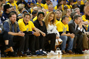 Entertainers Jay-Z and Beyonce look on during Game One of the Western Conference Semifinals between the New Orleans Pelicans and the Golden State Warriors at ORACLE Arena on April 28, 2018 in Oakland, California. NOTE TO USER: User expressly acknowledges and agrees that, by downloading and or using this photograph, User is consenting to the terms and conditions of the Getty Images License Agreement.