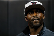 Former Atlanta Falcons player Michael Vick walks on the field prior to the game against the New Orleans Saints at the Georgia Dome on January 1, 2017 in Atlanta, Georgia.