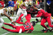 Tommylee Lewis #11 of the New Orleans Saints carries the ball against Damontae Kazee #27 and Derrick Coleman #40 of the Atlanta Falcons at Mercedes-Benz Stadium on December 7, 2017 in Atlanta, Georgia.