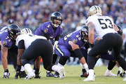 Quarterback Joe Flacco #5 of the Baltimore Ravens calls a play at the line of scrimmage in the second quarter against the New Orleans Saints at M&T Bank Stadium on October 21, 2018 in Baltimore, Maryland.