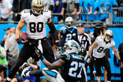 Jimmy Graham #80 of the New Orleans Saints has words for Quintin Mikell #27 of the Carolina Panthers after beating him for a touchdown during their game at Bank of America Stadium on December 22, 2013 in Charlotte, North Carolina. The Panthers won 17-13.