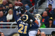 Janoris Jenkins #21 of the St. Louis Rams breaks up a touchdown pass intended for Jimmy Graham #80 of the New Orleans Saints at the Edward Jones Dome on December 15, 2013 in St. Louis, Missouri.  The Rams beat the Saints 27-16.
