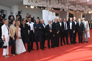 "( L_R) Cecile De France, Yulia Snigir,  Ludivine Sagnier, Jude Law,  Massimo Ghini (6th L) ,Silvio Orlandi (C) , John Malkovich (7th R) Paolo Sorrentino (5th L), Maurizio Lombardi, Javier Cámara and  Tomas Arana walks the red carpet ahead of ""The New Pope"" screening during the 76th Venice Film Festival at Sala Grande on September 01, 2019 in Venice, Italy."