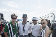 In this handout provided by FIA Formula E, Oliver Cheshire, David Gandy, Nelson Piquet Jr. (BRA), Panasonic Jaguar Racing, Jaguar I-Type II, and Natalie Dormer on the grid during the New York City ePrix, Round 11 of the 2017/18 FIA Formula E Series on July 14, 2018 in New York, United States.