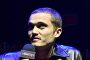 """Karl Glusman speaks on stage at FX's """"DEVS"""": An Exclusive First Look at Alex Garland's Television Debut during New York Comic Con 2019 Day 3 at Hammerstein Ballroom on October 05, 2019 in New York City."""