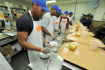 Jim Cordle New York Giants Team Members Deliver Thanksgiving Dinner To The Food Bank For NYC