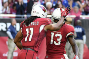 Wide receiver Larry Fitzgerald #11 of the Arizona Cardinals celebrates a thirteen yard touchdown with Jaron Brown #13 in the first half of the NFL game against the New York Giants at University of Phoenix Stadium on December 24, 2017 in Glendale, Arizona.