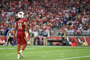 Wide receiver Larry Fitzgerald #11 of the Arizona Cardinals walks on the field in the second half of the NFL game against the New York Giants at University of Phoenix Stadium on December 24, 2017 in Glendale, Arizona.