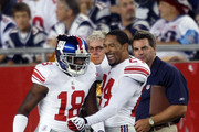 Hakeem Nicks #18 of the New York Giants is congratulated by teammate Terrell Thomas #24 after Nicks scored a touchdown against the New England Patriots on September 3, 2009 at Gillette Stadium in Foxboro, Massachusetts.