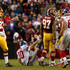 Eli Manning Photos - Quarterback Eli Manning #10 of the New York Giants is helped up after taking a hit against the Washington Redskins in the second half at FedExField on November 29, 2015 in Landover, Maryland. The Washington Redskins won, 20-14. - New York Giants v Washington Redskins