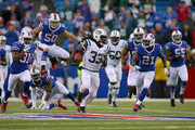 Chris Ivory #33 of the New York Jets runs for 69 yards against the Buffalo Bills at Ralph Wilson Stadium on November 17, 2013 in Orchard Park, New York. Buffalo won 37-14.