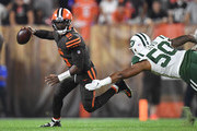 Tyrod Taylor #5 of the Cleveland Browns avoids a tackle by Frankie Luvu #50 of the New York Jets during the first quarter at FirstEnergy Stadium on September 20, 2018 in Cleveland, Ohio.