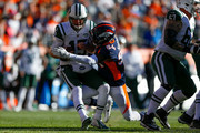 Inside linebacker Brandon Marshall #54 of the Denver Broncos sacks quarterback Josh McCown #15 of the New York Jets and forces a fumble during the first quarter at Sports Authority Field at Mile High on December 10, 2017 in Denver, Colorado.