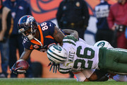 Wide receiver Demaryius Thomas #88 of the Denver Broncos is tackled by free safety Marcus Maye #26 of the New York Jets in the first quarter at Sports Authority Field at Mile High on December 10, 2017 in Denver, Colorado.