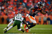 Wide receiver Demaryius Thomas #88 of the Denver Broncos makes a catch under coverage by cornerback Morris Claiborne #21 of the New York Jets in the fourth quarter of a game at Sports Authority Field at Mile High on December 10, 2017 in Denver, Colorado.