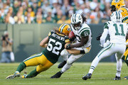 Running back Chris Ivory #33 of the New York Jets is tackled by outside linebacker Clay Matthews #52 of the Green Bay Packers during the NFL game at Lambeau Field on September 14, 2014 in Green Bay, Wisconsin. The Packers defeated the Jets 31-24.