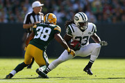Running back Chris Ivory #33 of the New York Jets rushes the football against the Green Bay Packers during the NFL game at Lambeau Field on September 14, 2014 in Green Bay, Wisconsin. The Packers defeated the Jets 31-24.