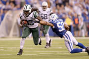 Chris Ivory #33 of the New York Jets runs the ball during the game against the Indianapolis Colts  at Lucas Oil Stadium on September 21, 2015 in Indianapolis, Indiana.