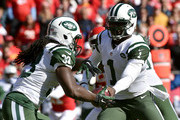 Michael Vick #1 of the New York Jets drops back to  Chris Ivory #33 of the New York Jets for a run play against the Kansas City Chiefs during the game at Arrowhead Stadium on November 2, 2014 in Kansas City, Missouri.