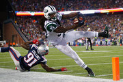 Chris Ivory #33 of the New York Jets is knocked out of bounds short of the goal line during the third quarter against the New England Patriots at Gillette Stadium on October 16, 2014 in Foxboro, Massachusetts.