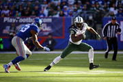 Chris Ivory #33 of the New York Jets runs with the ball against Jasper Brinkley #53 of the New York Giants at MetLife Stadium on December 6, 2015 in East Rutherford, New Jersey.
