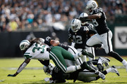 Chris Ivory #33 of the New York Jets is tackled by Malcolm Smith #53 of the Oakland Raiders during their NFL game at O.co Coliseum on November 1, 2015 in Oakland, California.