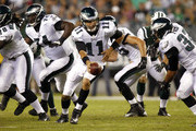 Trent Edwards #11 of the Philadelphia Eagles hands off the ball during a preseason game against the New York Jets at Lincoln Financial Field on August 30, 2012 in Philadelphia, Pennsylvania.