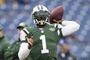 Michael Vick #1 of the New York Jets warming up before a game against the Tennessee Titans at LP Field on December 14, 2014 in Nashville, Tennessee.