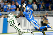 Marvin Jones #11 of the Detroit Lions reaches for the ball covered by Morris Claiborne #21 of the New York Jets in the first half at Ford Field on September 10, 2018 in Detroit, Michigan.