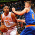 Kristaps Porzingis Photos - Al Horford #15 of the Atlanta Hawks drives against Kristaps Porzingis #6 of the New York Knicks at Philips Arena on January 5, 2016 in Atlanta, Georgia.  NOTE TO USER User expressly acknowledges and agrees that, by downloading and or using this photograph, user is consenting to the terms and conditions of the Getty Images License Agreement. - New York Knicks v Atlanta Hawks