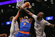 Carmelo Anthony #7 of the New York Knicks tries to take a shot as Brook Lopez #11 and Kevin Garnett #2 of the Brooklyn Nets defend at the Barclays Center on February 6, 2015 in the Brooklyn borough of New York City. NOTE TO USER: User expressly acknowledges and agrees that, by downloading and/or using this photograph, user is consenting to the terms and conditions of the Getty Images License Agreement.