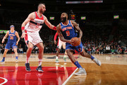 Kyle O'Quinn #9 of the New York Knicks handles the ball against Marcin Gortat #13 of the Washington Wizards on January 3, 2018 at Capital One Arena in Washington, DC. NOTE TO USER: User expressly acknowledges and agrees that, by downloading and or using this Photograph, user is consenting to the terms and conditions of the Getty Images License Agreement. Mandatory Copyright Notice: Copyright 2018 NBAE
