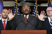 """U.S. Rep. Gregory Meeks (C) places his hands in the """"Don't Shoot"""" position while speaking out with members of the New York congressional delegation, including U.S. Rep. Hakeem Jeffries (L) and U.S. Rep. Joseph Crowley, on a Staten Island grand jury's decision not to bring criminal charges against a white police officer who was involved in the death of Eric Garner December 3, 2014 in Washington, DC. Garner died after being placed in a chokehold by New York City police officer Daniel Pantaleo."""